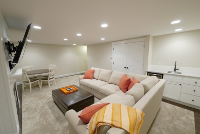 The sectional in the Family Media Room. Washer and dryer are located in the closet behind it.