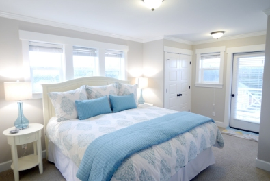 The Master Bedroom features a king size bed.