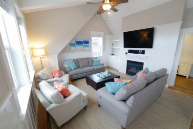 """The Living Room offers ample seating and a 60"""" television"""
