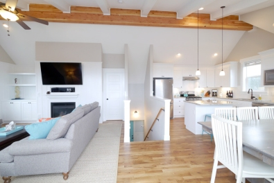 The top floor is accented by an exposed wood beam.