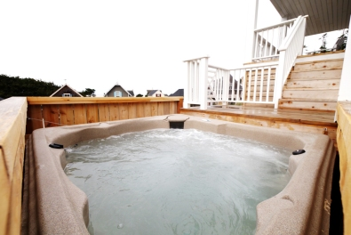 Relax under the sun or stars in the spacious hot tub.